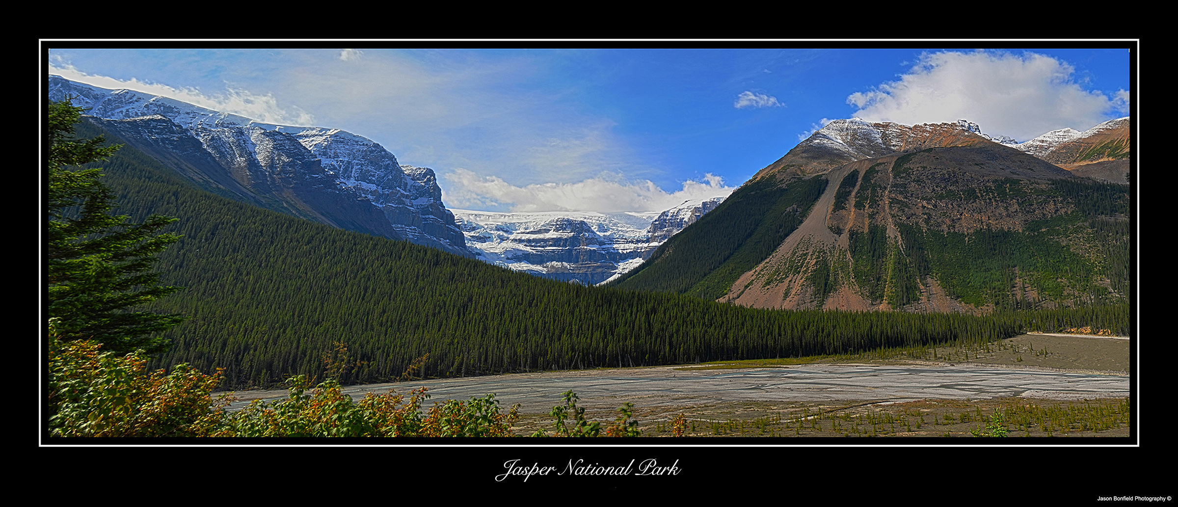 Panoramic landscape picture of mountains and glaciers in Jasper National Park in Alberta, Canada.