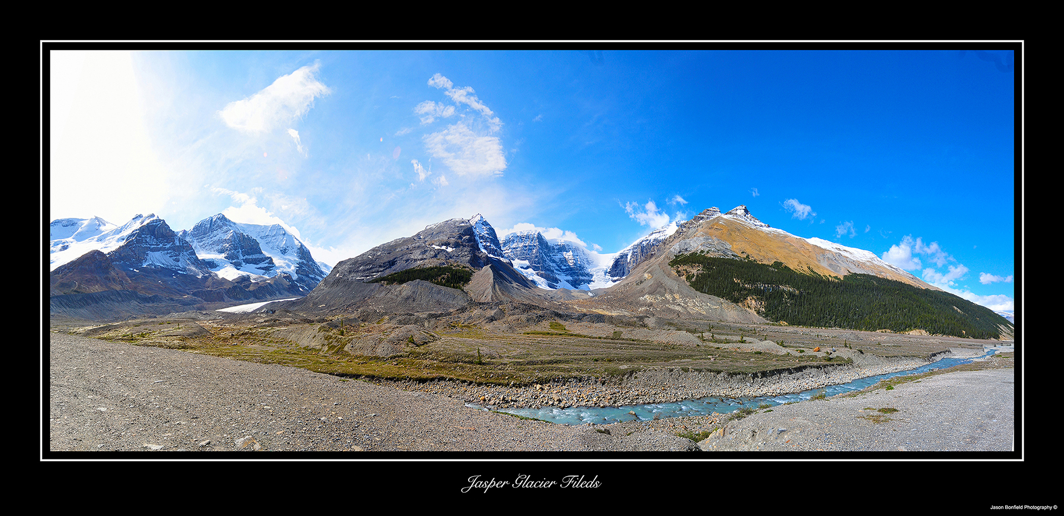 Panoramic landscape picture of mountains, glaciers, a river and blue sky in Jasper National Park in Alberta, Canada.