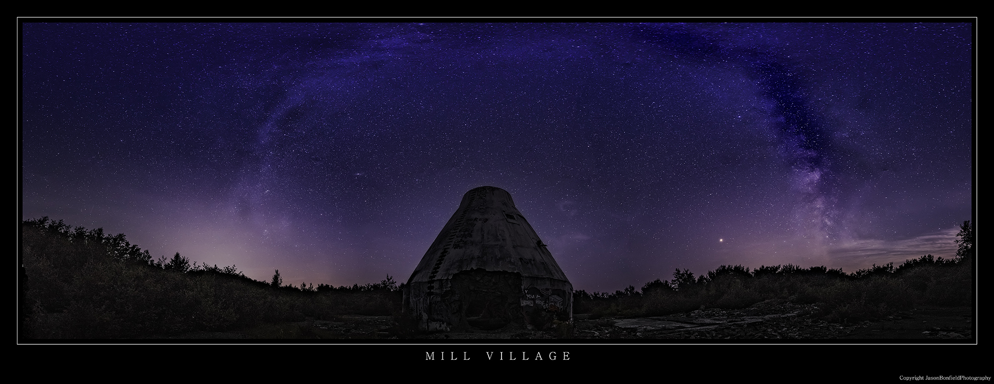 Panoramic night time landscape picture of  the abondoned Mill Village Satellite Earth Station in Nova Scotia with the Milky Way Galaxy visable in the sky