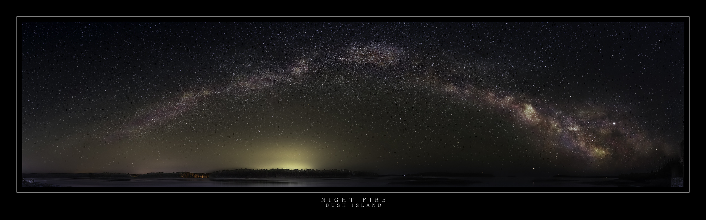 Night time panoramic landscape picture of the Milky Way Galaxy on fire over a silhouetted landscape taken at Rissers Beach Provinvcial Park, Lunenburg County Nova Scotia
