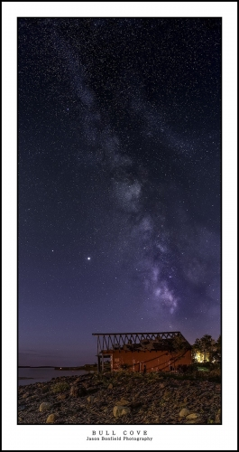 Panoramic lanscape of the Milky Way galaxy rising behind an abandoned boat house