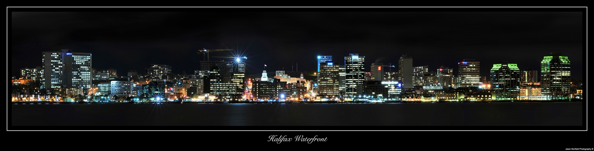 Nighttime panoramic landscape picture of Halifax city waterfront, Nova Scotia, Canada.