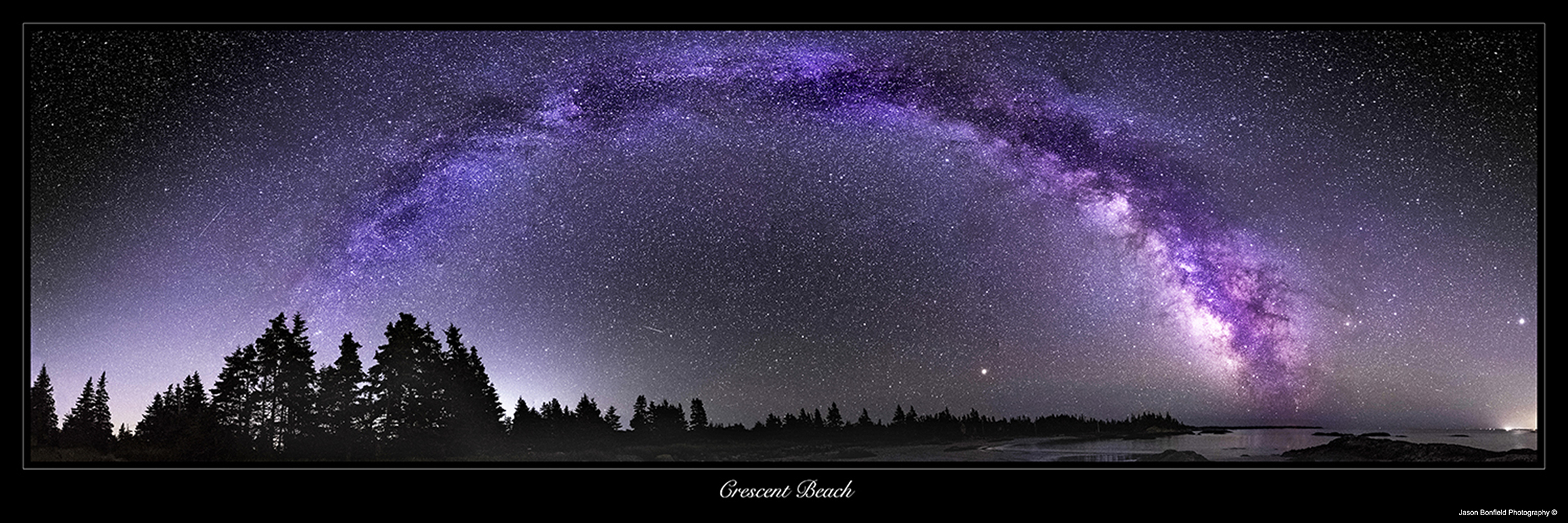 Panoramic nighttime landscape picture of the Milky Way galaxy over Crescent Beach in Nova Scotia, Canada.