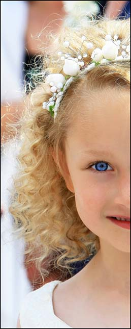 picture of a young girl with blonde hair and blue eyes with a decorative head band