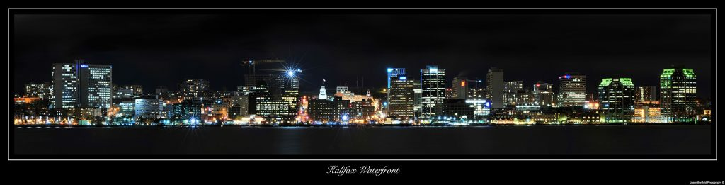 Night time panoramic landscape picture of Halifax city waterfront, Nova Scotia, Canada.